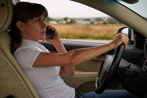 Using Phone While Driving A Danger Even If Hands Are Free Gray And White Law